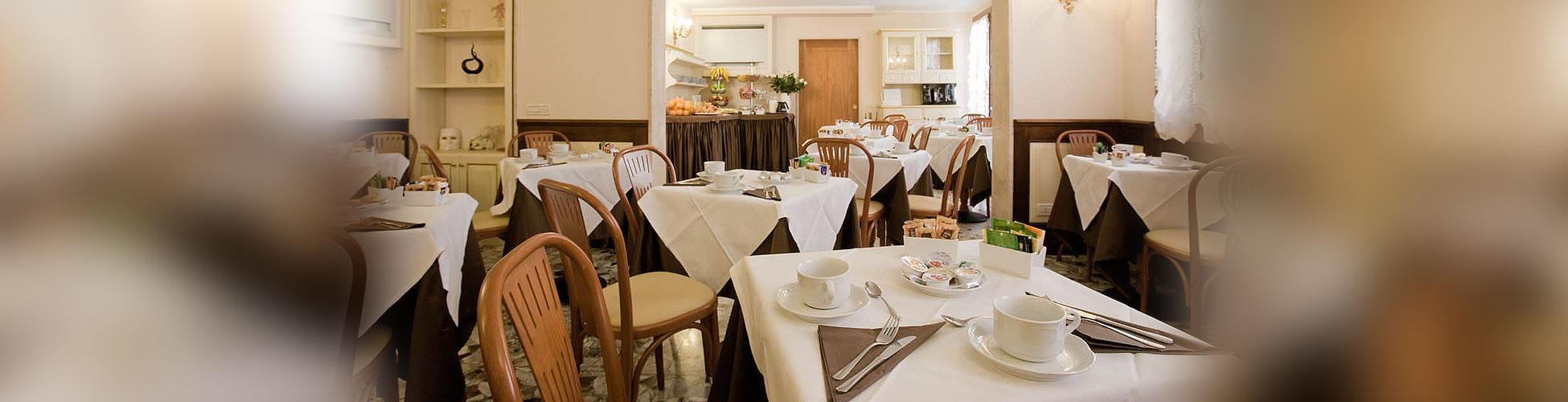 Hotel Mercurio - salle de petit déjeuner